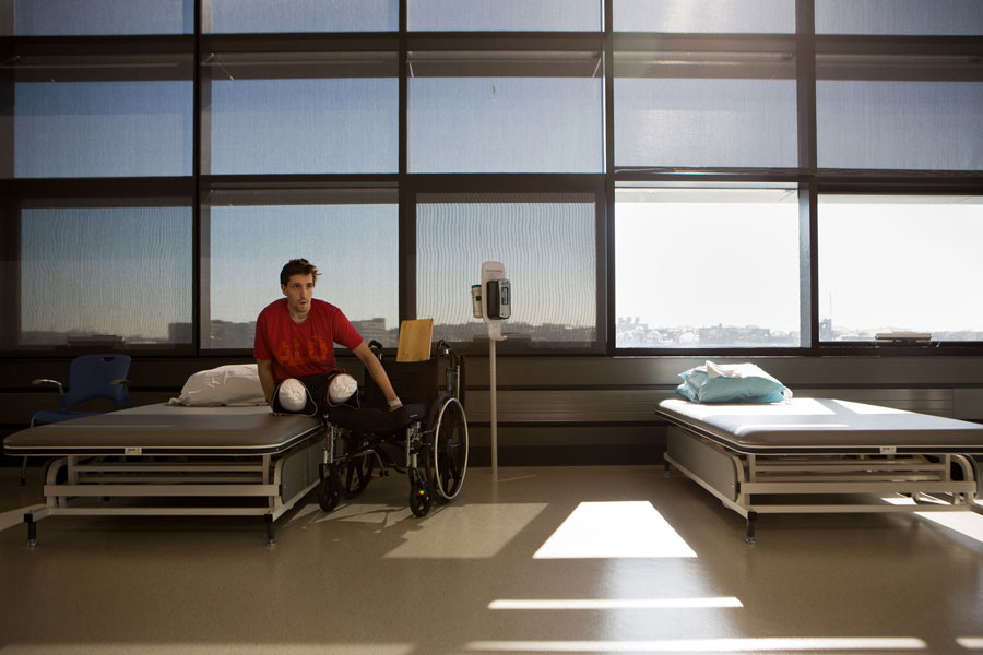 With his strength and balance improving, Bauman no longer needed a slide board (in back of his wheelchair) to move from the chair to his therapy mat at Spaulding Rehabilitation Hospital in Boston. (Josh Haner, The New York Times - May 7, 2013)