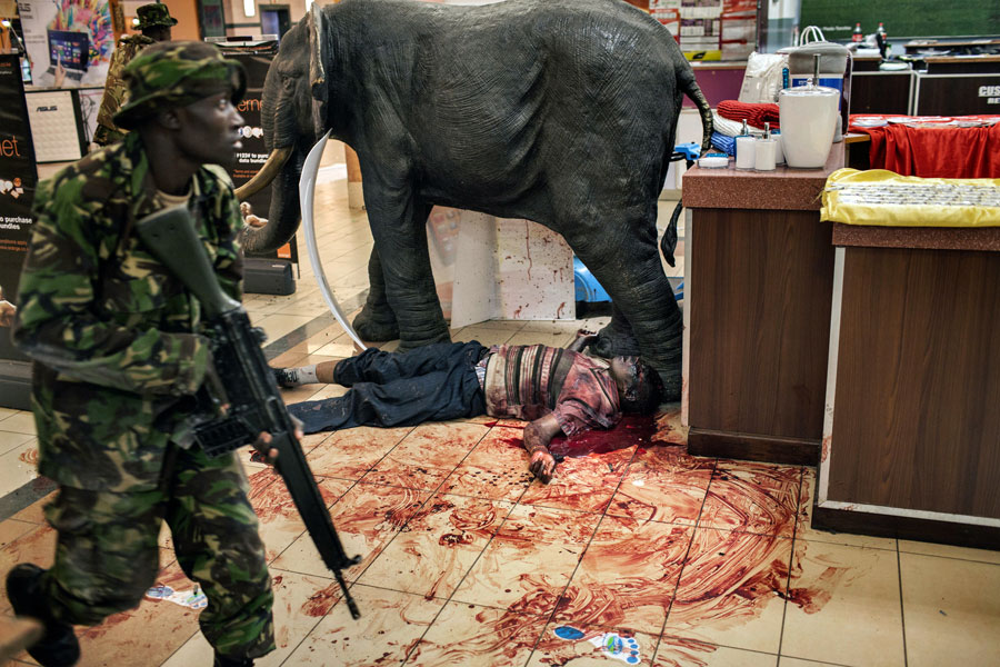 A victim lay at the feet of the statue of an elephant that was the mall's mascot. Hicks managed only a few pictures before being hurried away by the police. (Tyler Hicks, The New York Times - September 21, 2013)