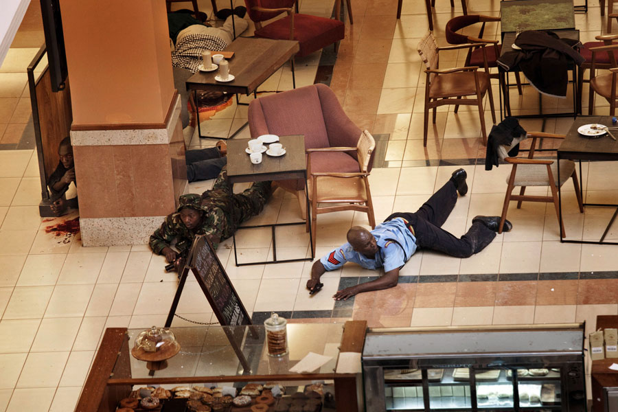 In a hastily abandoned cafe, soldiers and security officers tried to isolate the attackers and herd civilians to safety. They found many bodies in stores. (Tyler Hicks, The New York Times - September 21, 2013)